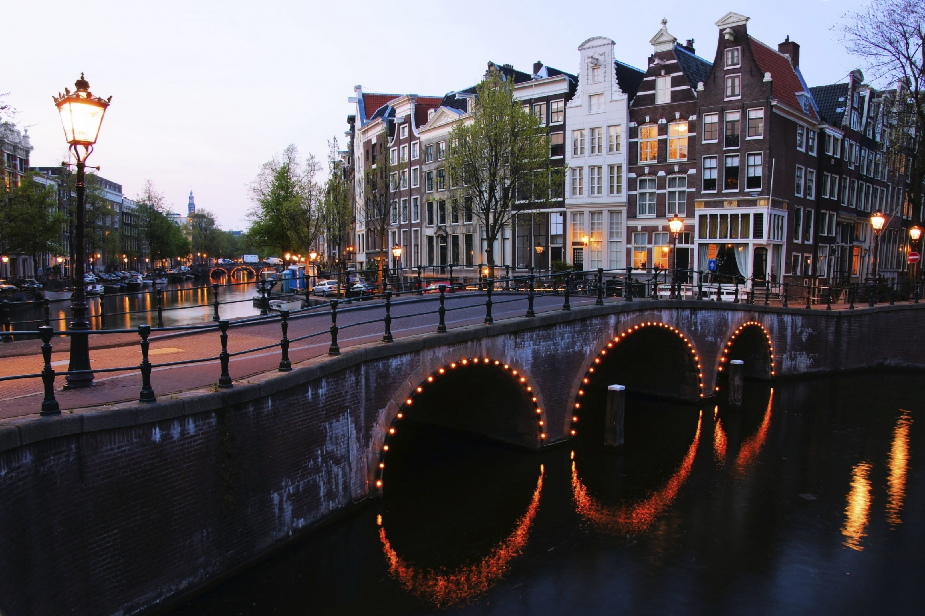 A picture of a street with a bridge and canal in Amsterda, where Guerrilla Games is based