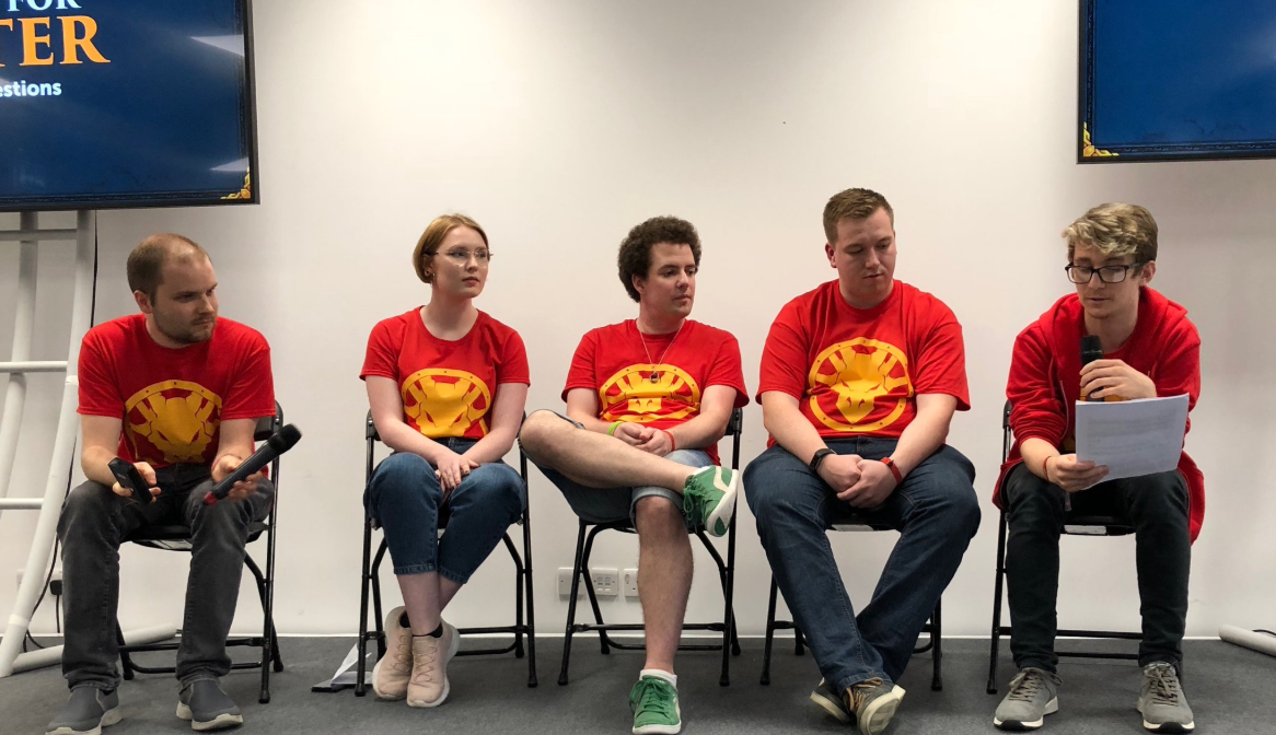 The web team on stage at RuneFest delivering a talk